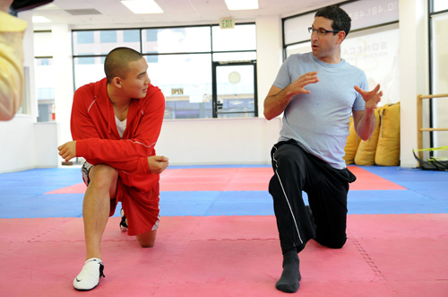 Josh Dorfman gives advice to Professional Martial Arts Athlete Jason Moontasri
